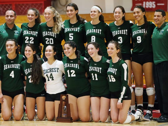 Seacrest Country Day School volleyball players and coaches celebrate beating Evangelical Christian School, 3-0, on Thursday, Oct. 20, 2016,  in the  3A-6 volleyball final at ECS in south Fort Myers.