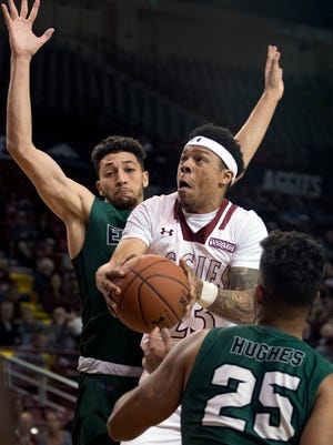 Zach Lofton and the New Mexico State Aggies face Davidson Friday night to open the Hawaiian Airlines Diamond Head Classic in Honolulu, Hawaii.