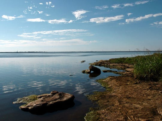 In this file photo, the sky reflects in the calm waters of the east side of Lake Arrowhead. Some property leases, owned by the city of Wichita Falls, at this lake will be increased by 20.75 percent in order to get them closer to market value. The city said they expend nearly double what they bring in for revenue to maintain these areas.