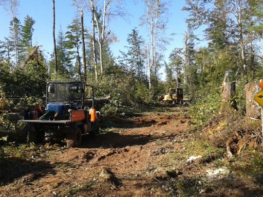 Crews from the Chequamegon-Nicolet, Huron-Manistee and Hiawatha National Forests worked together Sept. 16 to clear blown down timber from ATV Trail 421 on the Great Divide District in Sawyer County, Wisconsin.