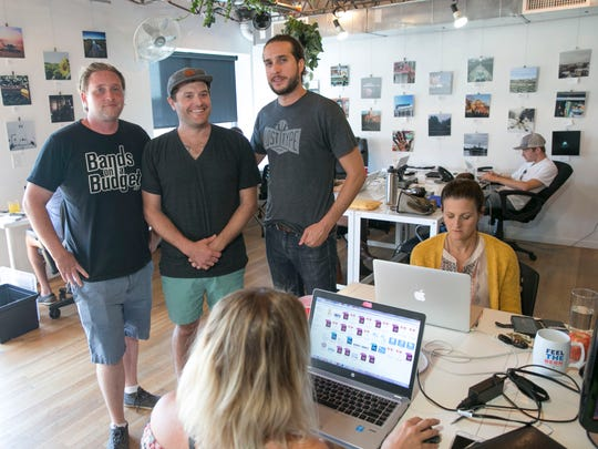 (Left to right) Danny Croak, Gregory Edgerton and Bret Morgan are partners in Cowerks, an office in Asbury Park where tech workers can set up shop for a day.