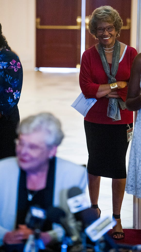 Press Secretary Eileen Jones looks on as Governor Kay