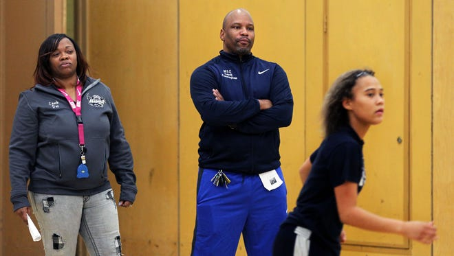 New Milwaukee Languages girls basketball coaches Alina and John Cunningham watch the team work out.