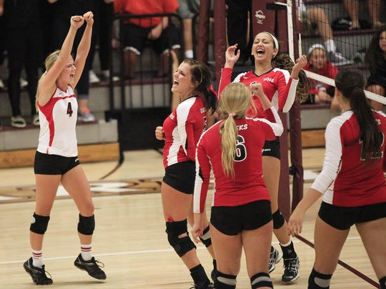 Wapahani celebrates a point in a 2014 match against Wes-Del. The two squads will be sectional rivals in Class 2A this season.