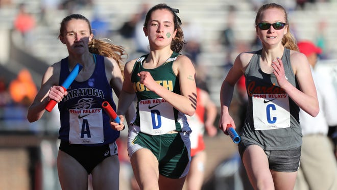 Emily Nugent (D), of North Hunterdon, runs the anchor leg of the distance medley at Penn Relays. North Hunterdon came in third place with a time of 12:01.17. Thursday, April 26, 2018