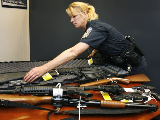 Detective Stephanie Humerickhouse puts away weapons