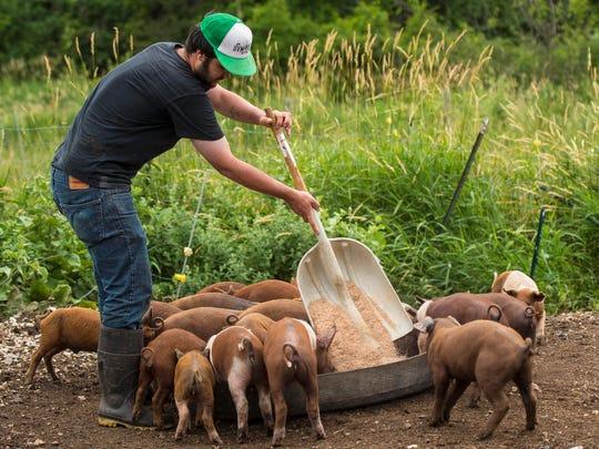 University of Vermont student Drew Anderson, seen feeding