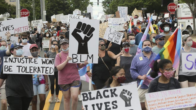 Protesters march on the streets around Government Plaza during the T-Town Peaceful Protest Sunday, June 7, 2020.
