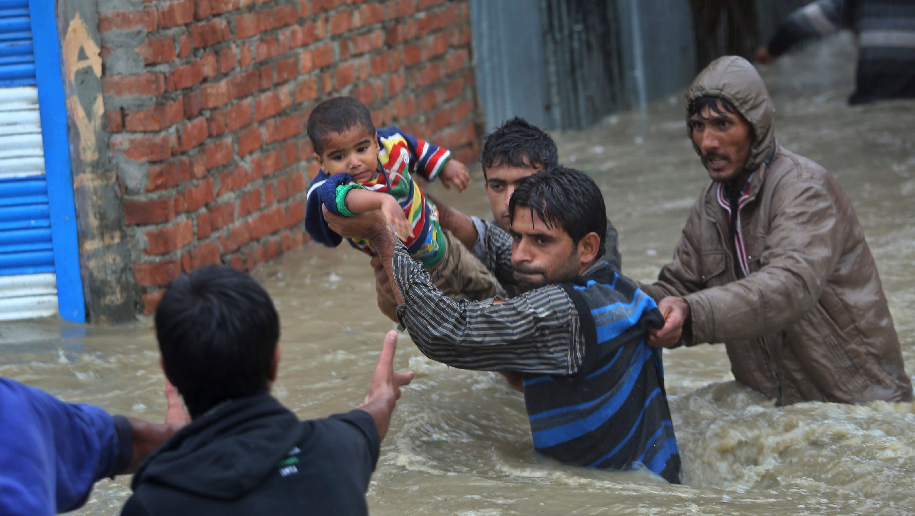 Bus swept away in Kashmir flooding; 70 missing