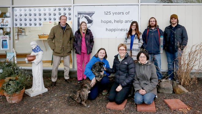 Chemung County Humane Society and SPCA staff and volunteers gather outside the facility on State Route 352 in Elmira Tuesday afternoon. The group celebrated the organization's 125th year of operation.