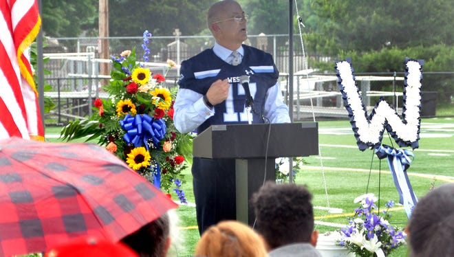 Wesley College President Robert Clark shares his sorrow and gives tribute to longtime Wolverine football coach Mike Drass at a memorial service Saturday.