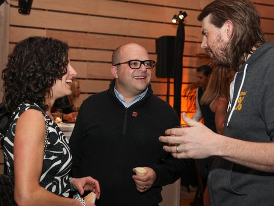 Erica Freeman Lawson, left, Jeff Lawson center, Founder, CEO and Chairman of Twilio and 2016 40 Under 40 honoree speaks with Mike Cannon-Brookes, right, of Atlassian, another 2016 list honoree, at the Fortune 40 Under 40 party on October 13, 2016 in San Francisco, California.