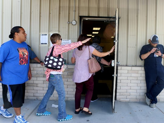 Voters enter the Center for the Deaf and Hard of Hearing  as they prepare to cast their ballot during early voting Tuesday, Nov. 1, 2016, in Corpus Christi.
