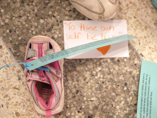 A small child's shoe rests on the floor of the Capitol
