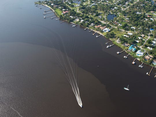 Polluted water from Lake Okeechobee discharges are seen in the St. Lucie River in April 2016.
