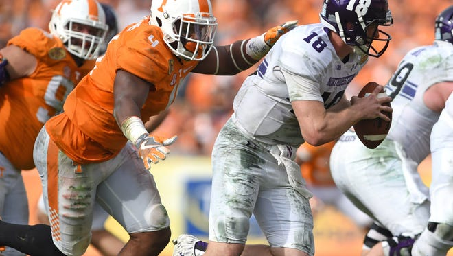 Tennessee defensive lineman LaTroy Lewis  chases down Northwestern quarterback Clayton Thorson during the Outback Bowl on Jan. 1 at Raymond James Stadium in Tampa, Fla.