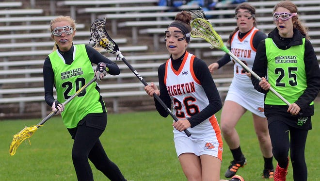 Brighton's Hannah Kelley (26) moves in for a first-half goal as Huron Valley defenders Sam Shefferly (20) and Katelyn Kasperian give chase.