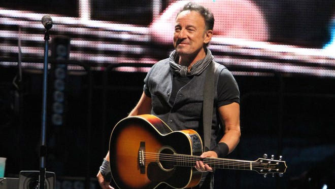 Bruce Springsteen: Let me show you how to hold your guitar.