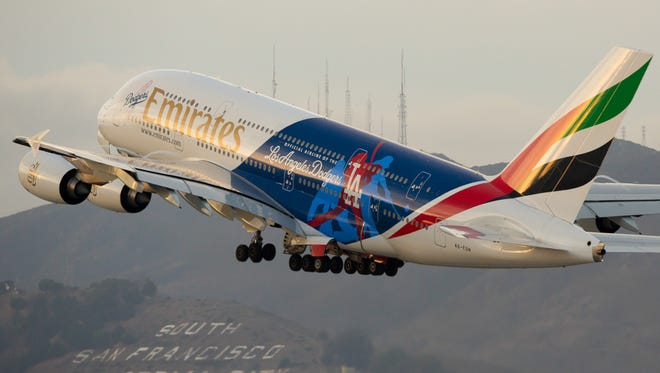 An Emirates Airbus A380 painted in a Los Angeles Dodgers livery departs for Dubai from San Francisco International Airport on Oct. 23, 2016.