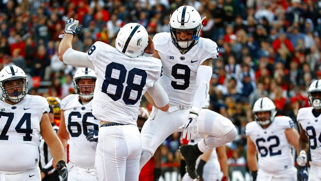 Penn State tight end Mike Gesicki, left, celebrates with quarterback Trace McSorley after scoring a touchdown on a pass from McSorley in the first half of an NCAA college football game against Maryland in College Park, Md., Saturday, Nov. 25, 2017.