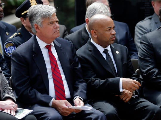 Senate Majority Leader Dean Skelos, R-Rockville Centre, left, and Assembly Speaker Carl Heastie, D-Bronx, during a ceremony at the New York State Police Officers Memorial on Tuesday, May 5, 2015, in Albany, N.Y. (AP Photo/Mike Groll)