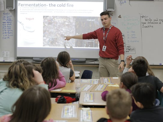 Ben Rush, a Farm to School AmeriCorps member, gives