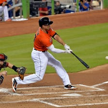 Aug 16, 2014: Miami Marlins right fielder Giancarlo Stanton (27) connects for a three run homer during the first inning against the Arizona Diamondbacks at Marlins Ballpark.