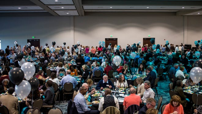 Hundreds of people eat and mingle during the SONS 25th anniversary banquet Thursday, May 11, 2017 at the Blue Water Area Convention Center.