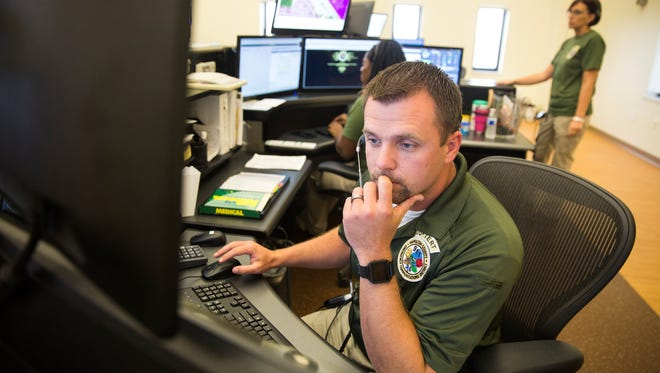 Dispatcher Adam Biggs came from Hamilton County in Tennessee to help with the high volume of emergency calls received in the wake of Hurricane Irma at the Collier County Emergency Services Center on Friday September 22, 2017.