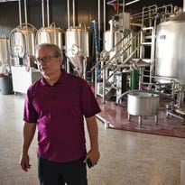 Roy Dodds stands in front of the brewhouse at the new Urban Moose Brewing Co. during an interview Wednesday, June 15, in Sauk Rapids.
