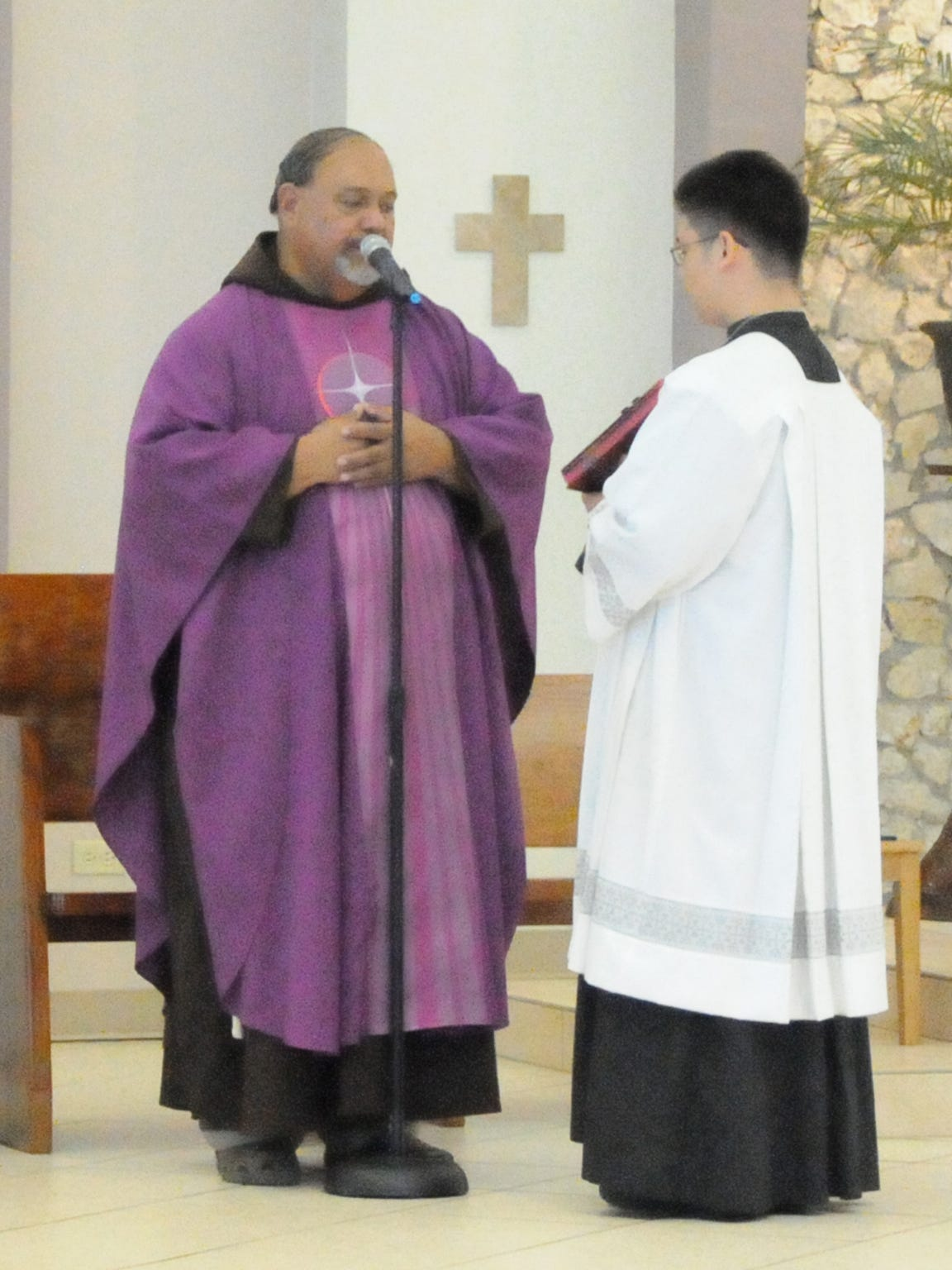 Fr. Joe English of Santa Teresita church, left, conducts
