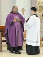Fr. Joe English of Santa Teresita church, left, conducts mass.
