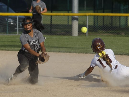 Ankeny's Gabi Bingham steals second base as the throw eludes Ankeny Centennial shortstop Franie Agot during the first game of Wednesday's doubleheader at Northview. The Jaguars posted a 5-3 victory in the opener before Ankeny rebounded with a 9-1 win to salvage a split of the twinbill.