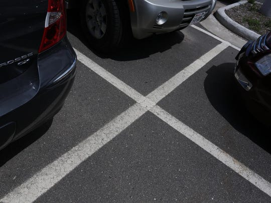 Parking space lines cross in the Central lot in downtown Marshfield.