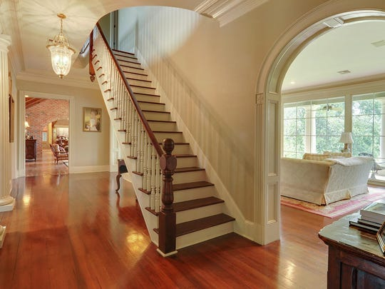 A grand staircase adorns the entrance of this home