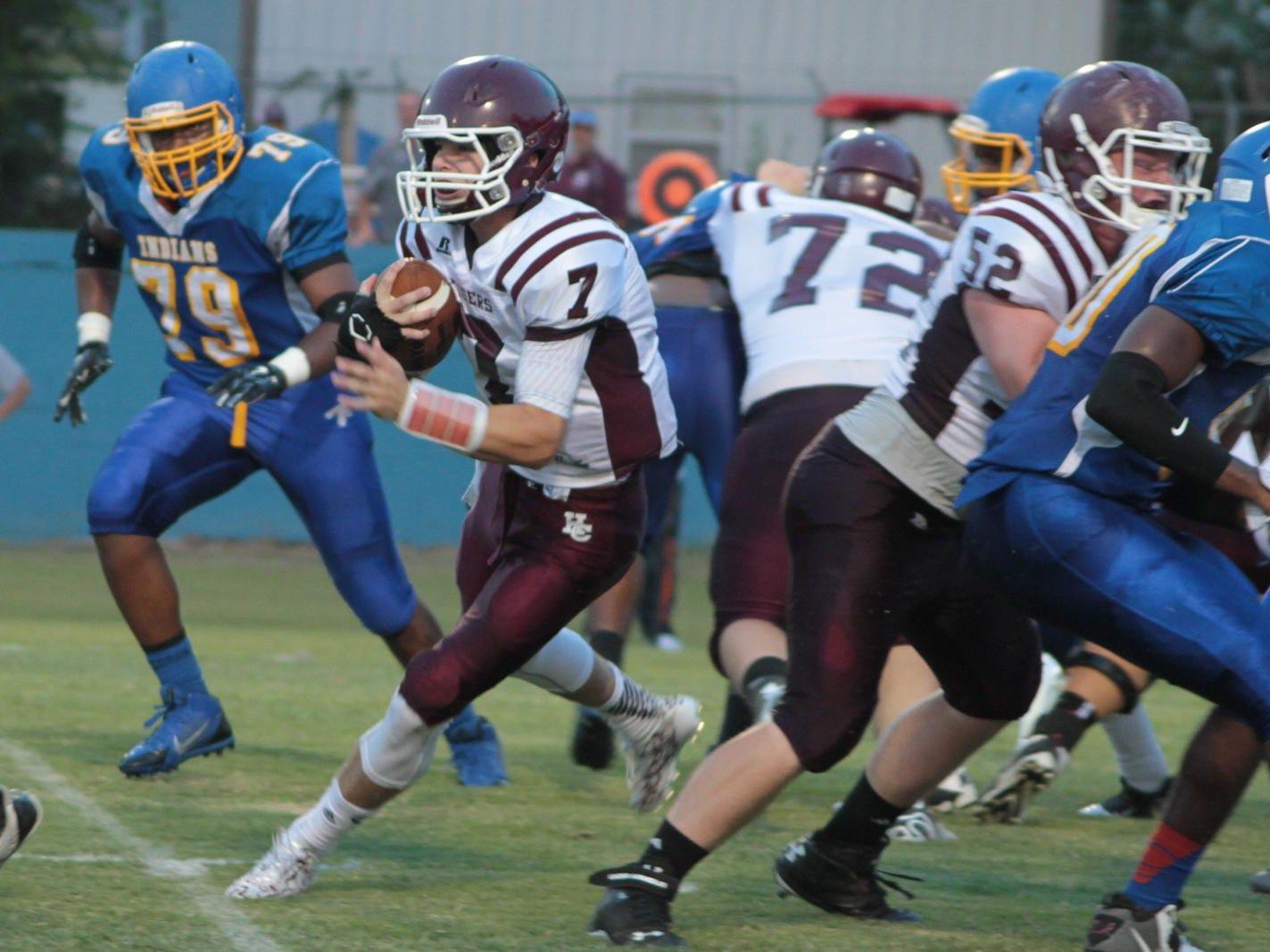 Hardin County quarterback runs the ball against North Side last season.