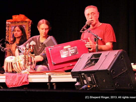 Krishna Das, shown leading a chanting session with musical accompaniment, returns to Bhakti Fest on Saturday.