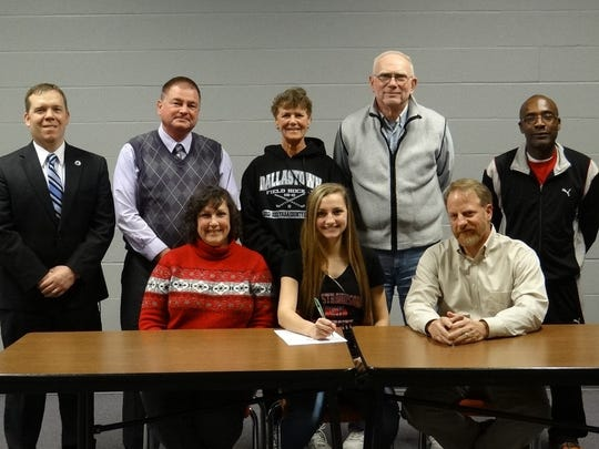 Front row, from left: mother Beth Chioda, Ashley Chioda, and father Maurice Chioda.  Back row, from left: principal Dr. Kevin Duckworth, athletic director Tory Harvey, Dallastown coach Jeri Myers, assistant coach Charlie Frey and Ballyhoo Crew club coach Dave Marsh. (SUBMITTED)