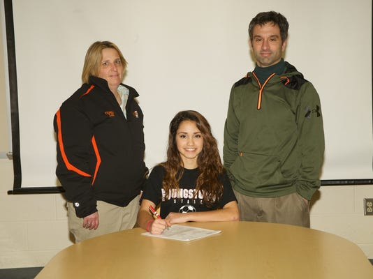 Central York senior Katherine Hackos sings her letter of intent to play soccer for Youngstown State University. Pictured is Central coach liz Critchfield, Hackos and her father Nathan Hackos. Submitted