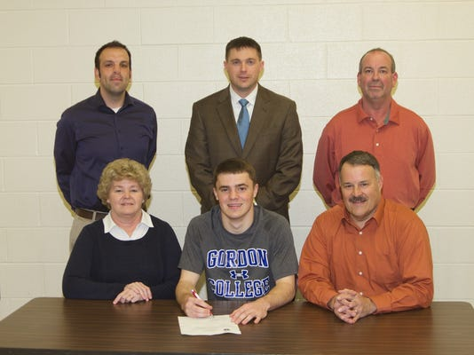Erik Rishel, (seated, front row, center) signed a letter of intent with Gordon College in Wenham, Mass. He is pictured with his parents, (front row, left to right, Erin Rishel and Jeff Rishel) and (back row, left to right), Coach Frank Lenno, High School Principal Ryan Caufman and Michael Cutwright. (SUBMITTED)