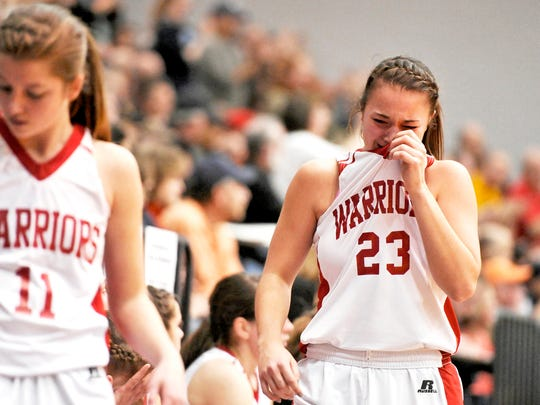 Susquehannock's Alexis Murphy reacts after the Warriors lost to Lancaster Catholic, 89-79, in double overtime Saturday in a PIAA Class AAA first-round game. (Daily Record/Sunday News -- Chris Dunn)