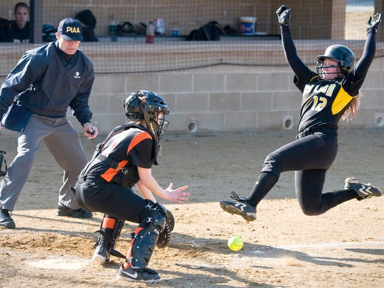 Red Lion's Taylor Gould scores a run in a win vs. York Suburban recently. The Lions pushed unbeaten Twin Valley on Saturday before falling, 15-7. (Daily Record/Sunday News -- File)