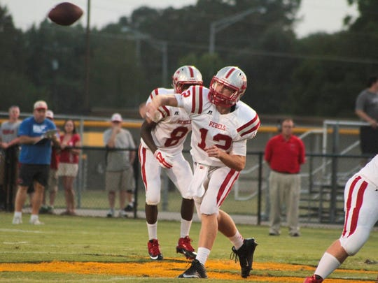 McKenzie's Jack Surber plays quarterback for the Rebels' football team.