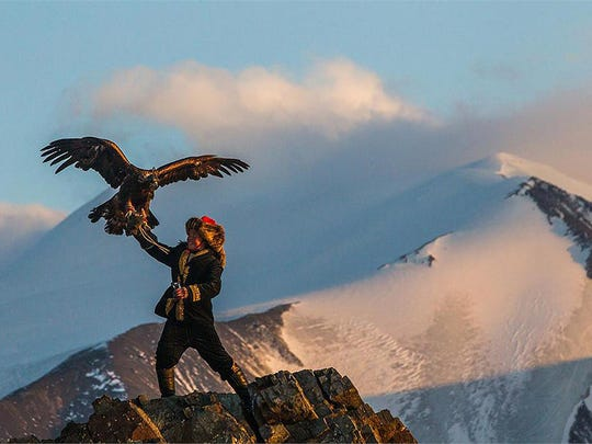 "In ""The Eagle Huntress,"" Aisholpan Nurgaiv practices her craft of training a majestic eagle to hunt prey on the Mongolian steppe."