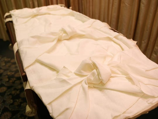 Davenport Family Funeral Home and Crematory offers linen burial shrouds for those seeking a green burial at their funeral home on Wednesday, Oct. 30, 2019 in Lake Zurich, Ill. The shroud consists of overlapping pieces of fabric that gently tie in front and feature woven carry straps and handles. (Stacey Wescott/Chicago Tribune/TNS)