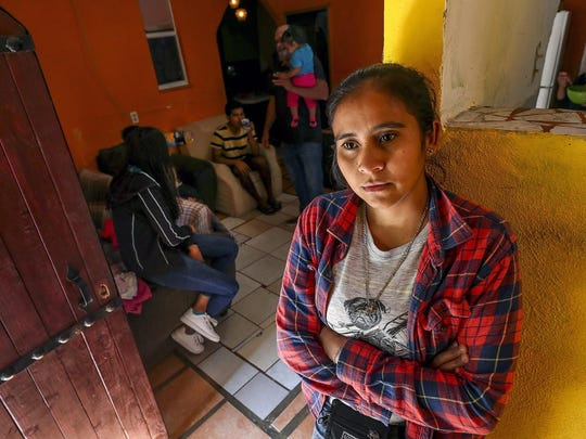 Yenni Lopez, 33, from Honduras, stands in Su Casa, a home for Central American migrants that she helps run, in Tijuana, Mexico on Thursday, November 14, 2019. (Hayne Palmour IV/San Diego Union-Tribune/TNS)