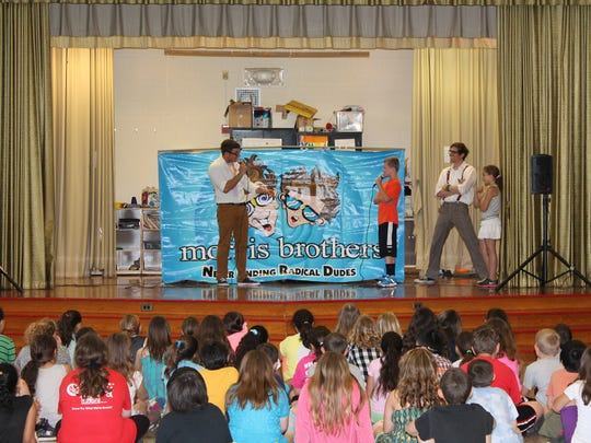 Fifth-graders Zach Angelone and Alexis Santos class volunteer to demonstrate anti-bullying techniques the Morris brothers taught during their assembly.