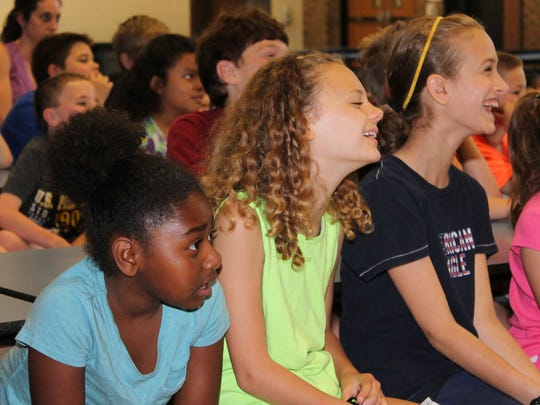 Third-graders Nyira Johnson, left, Lexi Winters and Erica Angelillo in Colleen Giametta's class get into the antics of the Morris Brothers Anti-Bullying Assembly.