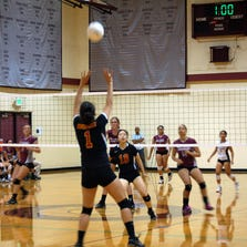 Newport opposite Grace Caraway sets the ball at the beginning of the third set.