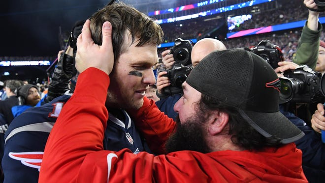 Tom Brady greets defensive coordinator Matt Patricia after defeating the Jacksonville Jaguars in the AFC Championship Game.